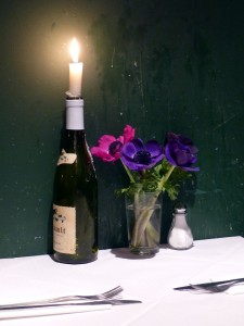 Lit Candle & Flowers at Andrew Edmunds