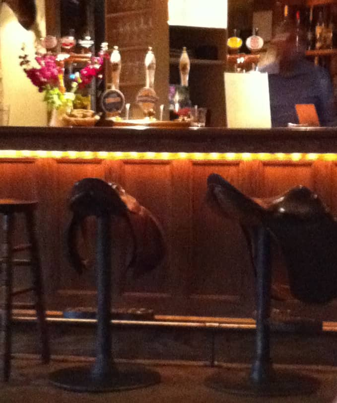 saddles as bar stools at the Feathered Nest